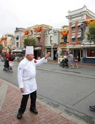 In this photo taken Sept. 20, 2013, Oscar Martinez, 77, greets diners at the Carnation Cafe at Disneyland in Anaheim, Calif. The chef is the park?s longest-tenured employee, beginning as a busboy nearly 57 years ago. He says he loves his job, and a new poll from the Associated Press-NORC Center for Public Affairs finds he?s not alone: Nine out of ten workers 50 and older say they?re satisfied with their work. (AP Photo/Matt Sedensky)