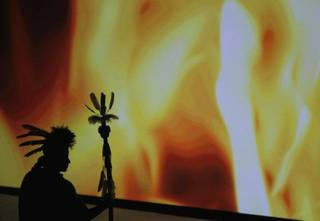 An actor in silhouette represents the Minko, the Chickasaw Nation's highest leader. Photo by Doug Hoke <strong>Doug Hoke</strong>