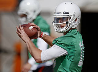 OKLAHOMA STATE UNIVERSITY / OSU / COLLEGE FOOTBALL: Oklahoma State quarterback Clint Chelf throws during an OSU spring football practice in Stillwater, Okla., Wednesday, March 13, 2013. Photo by Bryan Terry, The Oklahoman