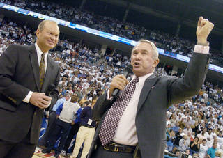 Hornets owner George Shinn, right, addresses the crowd along with Oklahoma City Mayor Mick Cornett, prior to the New Orleans/Oklahoma City Hornets season opening game against the Sacramento Kings, Tuesday, November 1, 2005, at the Ford Center, in Oklahoma City. by Bill Waugh/The Oklahoman