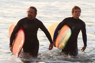 """This film image released by Twentieth Century Fox shows Gerard Butler, left, and Jonny Weston in a scene from """"Chasing Mavericks."""" AP Photo/Twentieth Century Fox, John P. Johnson John P. Johnson - AP"""