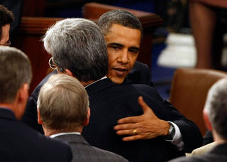 U.S. President Barack Obama hugs Senator Tom Coburn, R-Oklahoma, as he greets members of the U.S. Congress after addressing a joint meeting of the two legislative houses February 24, 2009 at the U.S. Capitol in Washington, DC. In his remarks Obama was expected to address the topics of the struggling U.S. economy, the budget deficit, and health care. (Photo by Chip Somodevilla/Getty Images)