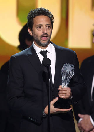 "Grant Heslov accepts the award for best picture for ""Argo"" at the 2013 Critics' Choice Movie Awards in Santa Monica, Calif. AP File photo Matt Sayles - Matt Sayles/Invision/AP"