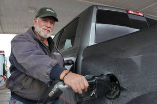 Larry Maestas, a Sandoval County rancher and oil and natural gas worker, fills up his pickup Monday in Bernalillo, N.M. Maestas drives as much as 200 miles a day and spent $18,000 on fuel last year. AP Photo
