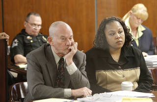 Dionne McKinney listens to testimony with her attorney during a trial at the Oklahoma County Courthouse in Oklahoma City, Friday December 14, 2012. Photo By Steve Gooch, The Oklahoman