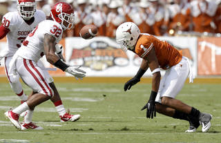 Oklahoma's Jamell Fleming (32) intercepts a pass beside Texas' Mike Davis (1) during the Red River Rivalry college football game between the University of Oklahoma Sooners (OU) and the University of Texas Longhorns (UT) at the Cotton Bowl in Dallas, Saturday, Oct. 8, 2011. Oklahoma won 55-17. Photo by Bryan Terry, The Oklahoman