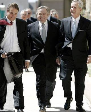 Former Senate leader Mike Morgan, center, walks to his arraignment Wednesday with his attorneys David Ogle, left, and Hal Ellis. John Clanton - The Oklahoman