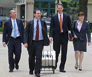 Hobby Lobby Attorney Kyle Duncan, second from right, and members of his team arrive at the federal courthouse in Denver on Thursday, May 23, 2013, for a full 10th Circuit hearing challenging the federal health care law. Hobby Lobby stores is challenging a federal mandate requiring it to offer employees health coverage that includes access to the morning-after birth control pill. The Oklahoma based arts and crafts chain says the mandate violates the religious beliefs of its owners. (AP Photo/Ed Andrieski) ORG XMIT: COEA203