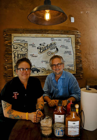 Chef and co-partner Kathryn Mathis with co-partner Chris Lower pose for a photo at the new Back Door Barbecue at 315 NW 23 in Oklahoma City. Photo by Chris Landsberger, The Oklahoman CHRIS LANDSBERGER - CHRIS LANDSBERGER