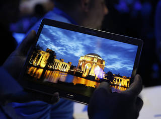 A member of the media tries out a new Samsung Galaxy Tab S on Thursday after the tablet's debut at a news conference in New York . AP Photo Kathy Willens - AP