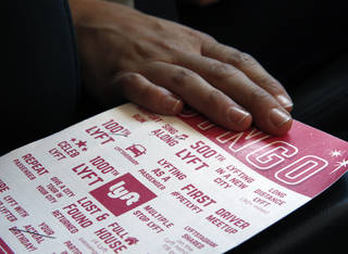 A Lyft bingo card is available for riders to play inside a private car driven by a part-time Lyft driver in Denver. AP Photo Brennan Linsley - AP