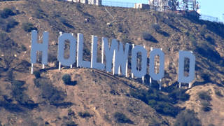 The Hollywood sign overlooks Hollywood & Vine.
