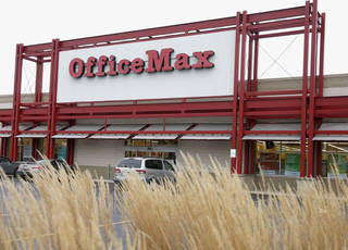 The exterior of an Office Max store is seen in Chicago. Office Depot has plans to shut down some of its U.S. stores. AP Photo Charles Rex Arbogast - AP
