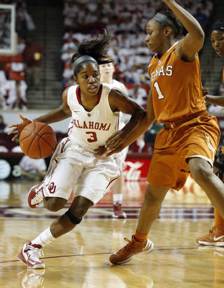Oklahoma Sooners' Aaryn Ellenberg (3) drives past Texas Longhorn's Empress Davenport (1) as the University of Oklahoma Sooners (OU) play the University of Texas (UT) Longhorns in NCAA, women's college basketball at The Lloyd Noble Center on Saturday, Jan. 19, 2013 in Norman, Okla. Photo by Steve Sisney, The Oklahoman