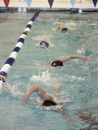 Edmond high school swimmers make their first laps in the new competitive swimming pool. PHOTO BY DAVID MCDANIEL, THE OKLAHOMAN. David McDaniel