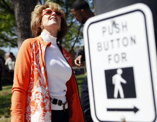 Ann Hargis, the first lady of Oklahoma State University, looks for a geocache hidden on campus. Photo by KT King, The Oklahoman KT King