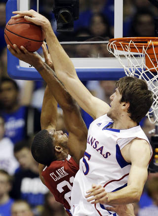 Kansas center Jeff Withey (5) blocks a shot by Oklahoma forward Cameron Clark (21) during the first half of an NCAA college basketball game in Lawrence, Kan., Saturday, Jan. 26, 2013. (AP Photo/Orlin Wagner) ORG XMIT: KSOW105