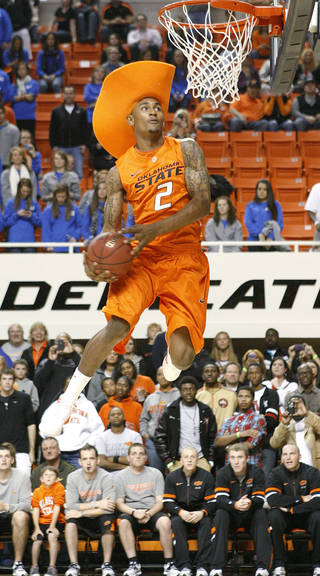 OSU's Le'Bryan Nash attempts a dunk during a slam dunk contest for Oklahoma State's Homecoming and Hoops, Friday, Oct. 28, 2011, at Gallagher-Iba Arena in Stillwater, Okla. Photo by Bryan Terry, The Oklahoman