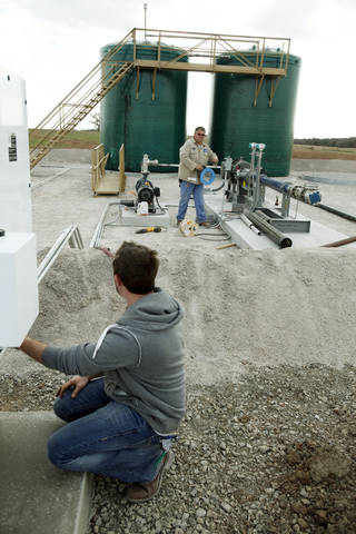 Workers prepare a disposal well near Crescent, Oklahoma, in March, 2012, By Paul Hellstern, The Oklahoman Archives