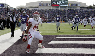 OU's Brennan Clay sets the ball down after scoring on a 64-yard touchdown run during the Sooners' 41-31 win on Saturday. Clay amassed a career-high 200 yards rushing against Kansas State. Photo by Bryan Terry, The Oklahoman