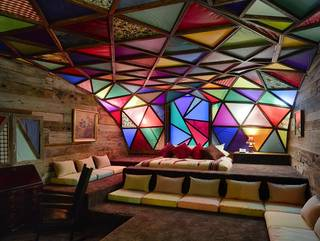 The most popular room at the flagship 21C Museum Hotel in Louisville, Ky., is the Asleep in the Cyclone room, which is designed as a tribute to the 1960s counter-culture commune era. Photo provided by Ryan Kurtz