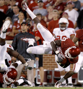 Oklahoma's Brandon Williams (23) flies through the air during the college football game between the University of Oklahoma Sooners (OU) and the Ball State Cardinals at Gaylord Family-Oklahoma Memorial Stadium on Saturday, Oct. 01, 2011, in Norman, Okla. Photo by Bryan Terry, The Oklahoman ORG XMIT: KOD