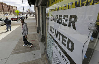 A help wanted sign is posted at a barber shop in Richmond, Va. U.S. employers added just 88,000 jobs in March, the fewest in nine months. AP Photo