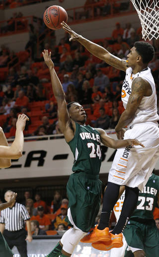 Oklahoma State wing Le'Bryan Nash (2) blocks a shot by Mississippi Valley State guard Anthony McDonald (24) in the first half of an NCAA college basketball game in Stillwater, Okla., Friday, Nov. 8, 2013. (AP Photo/Sue Ogrocki)