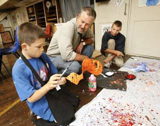 """The Rev. Robin Meyers, center, senior pastor of Mayflower United Church of Christ, looks on as seventh-grader Eric Mullen, 12, and eighth-grader James Mercer, 15, work on sculptures during the """"Taft Power Hour,"""" a before-school arts program sponsored by Meyers' Oklahoma City church at Taft Middle School, 2901 NW 23. PAUL B. SOUTHERLAND - PAUL B. SOUTHERLAND"""