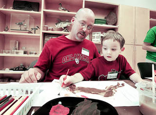 """Sean Hutson and son Jake, 6, work on their project during the """"Art on the Wild Side"""" workshop, a joint project of Firehouse Art Center and Sam Noble Museum drawings around theme of Bob Kuhn's exhibit, """"Drawing on Instinct."""" on Saturday, Aug. 17, 2013 in Norman, Okla. Photo by Steve Sisney, The Oklahoman"""