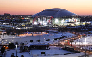 The sun sets as a view of Cowboys Stadium is shown, Friday, Feb. 4, 2011, in Arlington, Texas. The Pittsburgh Steelers will play the Green Bay Packers in the NFL's premier football game, Super Bowl XLV on Sunday. (AP Photo/Tony Gutierrez) ORG XMIT: TXTG110