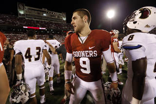 Oklahoma's Trevor Knight (9) shakes hands with Warhawks players following the college football game where the University of Oklahoma Sooners (OU) play the University of Louisiana Monroe Warhawks at Gaylord Family-Oklahoma Memorial Stadium in Norman, Okla., on Saturday, Aug. 31, 2013. Photo by Steve Sisney, The Oklahoman