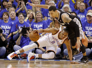 Oklahoma City's Russell Westbrook (0) keeps control under San Antonio's Danny Green (4) during Game 4 of the Western Conference Finals between the Oklahoma City Thunder and the San Antonio Spurs in the NBA playoffs at the Chesapeake Energy Arena in Oklahoma City, Saturday,June 2, 2012. Photo by Bryan Terry, The Oklahoman