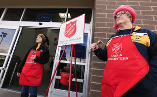 Volunteers Stacey Steinmetz and Pam Platz, University of Central Oklahoma employees, ring bells while collecting donations for the Salvation Army at a local Wal Mart Edmond Thursday, Dec. 19, 2013. Photo by Paul B. Southerland, The Oklahoman PAUL B. SOUTHERLAND - PAUL B. SOUTHERLAND