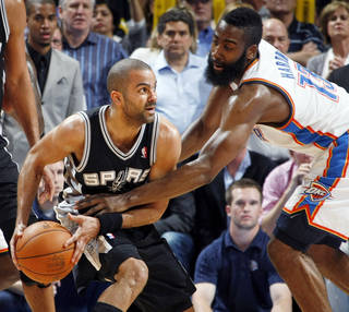 Oklahoma City's James Harden (13) pressures San Antonio's Tony Parker (9) during the NBA basketball game between the Oklahoma City Thunder and the San Antonio Spurs at Chesapeake Energy Arena in Oklahoma City, Friday, March 16, 2012. San Antonio won, 114-105. Photo by Nate Billings, The Oklahoman