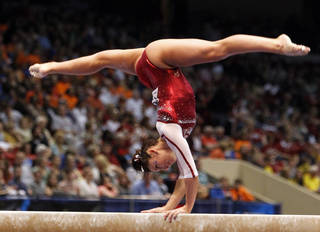Oklahoma's Taylor Spears competes on the balance beam during the NCAA college women's gymnastics championships on Saturday, April 19, 2014, in Birmingham, Ala. (AP Photo/Butch Dill)