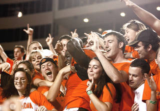 OSU's Dez Bryant, center, celebrates with fans after beating Texas A&M last year. OSU has sold about 31,500 season tickets for 2009. PHOTO BY SARAH PHIPPS, THE OKLAHOMAN