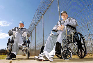 In this March 14, 2005, photo, former Oklahoma inmates Billie Garner and Trittichuh Hicks pose in their wheelchairs in the outdoor visiting area of the Joseph Harp Correctional Center. Garner, left, has since been released from prison. Hicks died in January 2011 while in custody at the same prison, about a month before his 89th birthday. Photo by David McDaniel, The Oklahoman Archives
