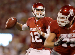 Oklahoma's Landry Jones (12) drops back to pass during the college football game between the University of Oklahoma Sooners (OU) and the University of Missouri Tigers (MU) at the Gaylord Family-Oklahoma Memorial Stadium on Saturday, Sept. 24, 2011, in Norman, Okla. Photo by Bryan Terry, The Oklahoman ORG XMIT: KOD