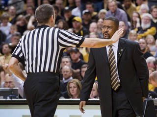 Missouri coach Frank Haith, right, argues a call with a referee during the second half of an NCAA college basketball game against Texas A&M on Monday, Jan. 16, 2012, in Columbia, Mo. Missouri won the game 70-51. (AP Photo/L.G. Patterson) ORG XMIT: MOLG107