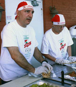 Joe Mondalek and Verna Pierce prepare traditional Lebanese food such as kafta, which is ground beef with herbs and spices, and hummus sandwiches at the third annual Lebanese Heritage and Food Festival at Our Lady of Lebanon Church in Norman. PHOTO BY LYNETTE LOBBAN, FOR THE OKLAHOMAN