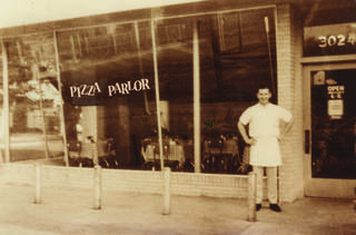 Ken Selby, chairman and founder of Ken's Pizza, which became Mazzio's LLC, stands outside an early Ken's Pizza in this vintage photo. PHOTO PROVIDED BY MAZZIOS PROVIDED