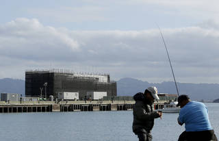 Two men fish near a Google barge Oct. 19 on Treasure Island in San Francisco. AP Archives Photo Jeff Chiu - AP