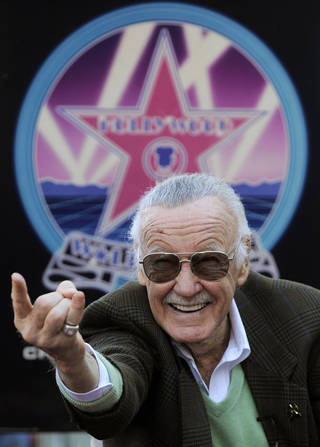 FILE - In this Jan. 4, 2011 file photo, Comic book creator Stan Lee strikes the Spiderman pose as he poses after receiving a star on the Hollywood Walk of Fame in Los Angeles. Lee wants to see the likes of Spider-Man and X-Men weaving between skyscrapers in Shanghai and battling enemies on the Great Wall. Lee has announced a joint venture with a Hong Kong investment company that aims to roll out a new superhero franchise targeted at Chinese and foreign audiences. (AP Photo/Chris Pizzello, File)