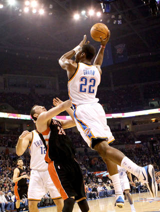 Oklahoma City's Jeff Green puts up a shot over Toronto's Hedo Turkoglu during the Thunder's 119-99 win Sunday at the Ford Center. PHOTO BY JOHN CLANTON, THE OKLAHOMAN