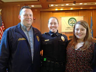 Midwest City police Lt. Laura Henry stands with her husband, Matthew, and their daughter Natalie, 14, after a promotion ceremony. PHOTO PROVIDED