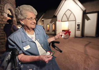 Docent volunteer Ruth Booton is shown at the National Cowboy & Western Heritage Museum with some of the old-fashioned ornaments made during a Saturdays for Kids activity, with this year's event scheduled for Dec. 7. David McDaniel - The Oklahoman