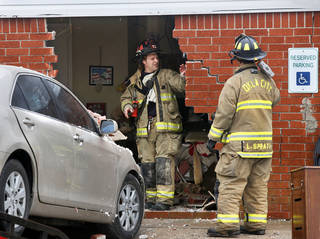 Oklahoma City firefighters look on Thursday at damage to the north wall of the Skyview Nursing Center, 2200 N Coltrane. Photo by Jim Beckel, The Oklahoman