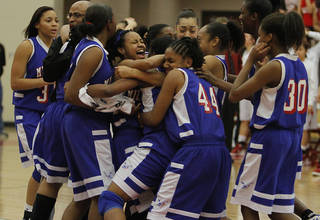 Millwood celebrates their win over Kansas during the semi final 3A girls State Basketball Championship game between Millwood High School and Kansas High School at Yukon High School on Friday, March 9, 2012 in Yukon, Okla. Photo by Chris Landsberger, The Oklahoman