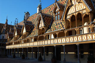 The geometrically patterned tiles decorating the steep roofs of the Hospice de Beaune are an art form in themselves. (Photo by Rick Steves)